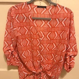 Orange pattern blouse with a tie front